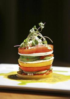 A stacked tomato salad from Avila features heirlooms.